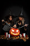 Halloween witches. With a pumpkin Stock Photography