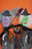 Halloween, witches, cat, craft. Halloween toys, witches made of a wooden spoon, tissue paper and pipe cleaners and a cat made of an old pencil and pipe cleaners royalty free stock photos