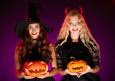 Halloween witches with pumpkins Stock Image