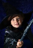 Halloween Wizard. Portrait of a cute young boy (3) in sorcerer costume for Halloween, casting a magic spell Stock Photography