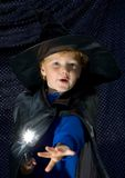 Halloween Wizard Kid. Cute young boy (3) in sorcerer costume for Halloween, casting a magic spell royalty free stock photography