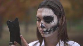 Halloween. Woman with a scary Halloween makeup. Girl with a scary Halloween makeup. Halloween holiday. All Saints` Night. Halloween concept. Best Halloween stock footage