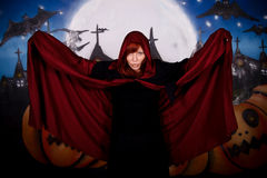 Halloween woman vampire. Halloween woman horror character vampire. Studio, painted themed background Royalty Free Stock Images