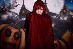 Halloween woman vampire. Halloween woman horror character vampire. Studio, painted themed background Royalty Free Stock Photography