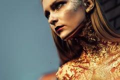 Halloween woman vampire with creative art make up Stock Photography