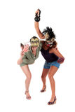Halloween women masks. Young Halloween women with ugly scary masks, fighting. Studio shot. White background Royalty Free Stock Photo