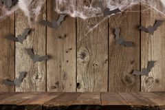 Halloween wood plank background with spiderwebs and bats Royalty Free Stock Photo