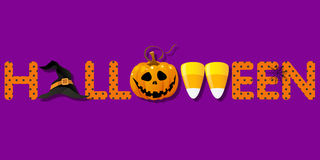 Halloween word with witch hat and pumpkin and candy corns Royalty Free Stock Images