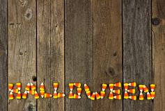 HALLOWEEN written with candy corn over rustic wood Stock Photos