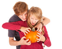 Halloween - young couple with pumpkin Royalty Free Stock Image