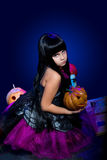 Halloween, young witch Stock Photography