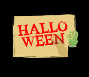Halloween Zombie hand holding white sheet. Green hand holds and. Signboard Royalty Free Stock Images