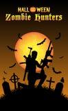 Halloween zombie hunter with machine gun at graveyard Stock Image