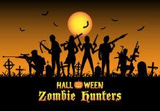 Halloween zombie hunters team at graveyard Stock Photos