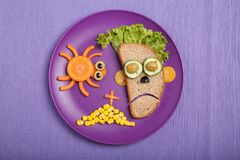 Halloween zombie and spider made of bread vegetables Stock Images
