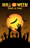 Halloween zombies hand in a graveyard Stock Images