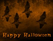 Halloween2. 2d halloween illustration of bats flying against an orange smokey background with the text Happy Halloween Royalty Free Stock Image