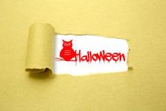 Halloweenowy tekst na brown papierze Fotografia Stock