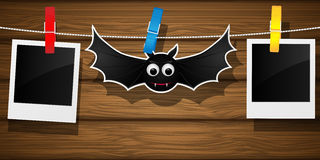 Hallowen background with flying bat and blank photo frame. Royalty Free Stock Photo