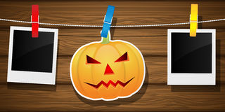 Hallowen background with pumpkin and blank photo frame. Royalty Free Stock Photography