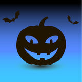 Hallowen pumpkin with bats on blue background Stock Image