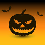 Hallowen pumpkin with bats on yellow background Royalty Free Stock Images