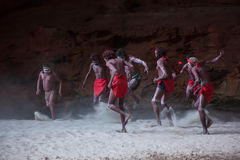 HALLS CREEK, WESTERN AUSTRALIA, AUSTRALIA - JULY 13, 2013. Men of the `Karjanarna Jaru` perform a traditional dance depicting an `initiation ceremony` for a Stock Image