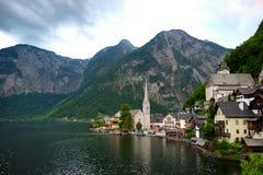 Hallstatt Österrike/by Arkivfoto