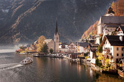 Hallstatt, Austria. Beautiful town of Hallstatt in Austria at sunset reflecting in mountain lake Stock Images