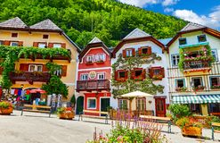 Hallstatt Austria central market square traditional houses. Hallstatt, Austria. Central market square Marktplatz. Traditional houses among green knolls. Windows stock photos