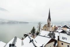 HALLSTATT, AUSTRIA - JANUARY 2019: view over Evangelische Pfarrkirche and old town in winter stock image