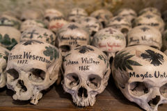 Decorated Skulls in a Bone House of Hallstatt, Austria. HALLSTATT, AUSTRIA - JULY 23, 2015: Decorated Skulls in a Bone House of Hallstatt, Austria on July 23 stock photo