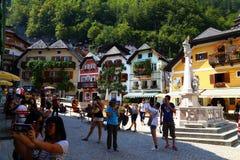 Tourists on the streets of town HALLSTATT, AUSTRIA . Stock Photo
