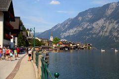 Tourists on the streets of town HALLSTATT, AUSTRIA . Royalty Free Stock Images