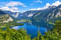 Hallstatt Austria top view to lake Hallstattersee. Hallstatt, Austria. Top view to lake Hallstattersee among austrian Alps mountains and green trees in forest Royalty Free Stock Photo
