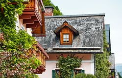 Hallstatt Austria vintage houses with wooden balconies. Hallstatt Austria. Houses with wooden balconies, windows and roofs. Racy antique traditional austrian Royalty Free Stock Photography