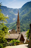 Hallstatt. Church and mountains. Royalty Free Stock Photography
