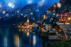Free Hallstatt In Austria Celebrating New Years Eve With Flashing Colorful Firework Stock Photo - 130133800