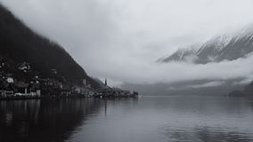 Hallstatt lake and village in Austria on a misty, winter day stock photo