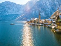 Hallstatt lakeside town in the Alps moutain ship on a beautiful cold sunny day with blue sky and c royalty free stock photo
