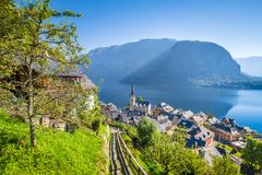 Hallstatt lakeside town in summer, Salzkammergut, Austria. Classic postcard view of famous Hallstatt lakeside town in the Alps with idyllic pathway leading Royalty Free Stock Image