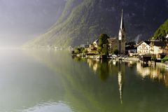 Hallstatt at Morning with Sunlight and Reflection on the Lake, Austria, Europe Stock Photo