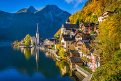 Hallstatt mountain village in fall, Salzkammergut, Austria. Scenic picture-postcard view of famous Hallstatt mountain village with Hallstatter See in the Royalty Free Stock Photos