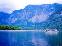 Hallstatt tourist boat cruising in the lake with foggy view of a Stock Photography