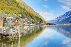Hallstatt under blue sunny sky with reflections on smooth lake water Royalty Free Stock Image
