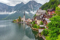 Hallstatt village in Alps at cloudy day Stock Images