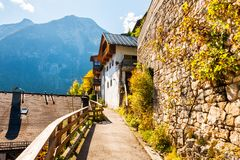 Hallstatt village in Austrian Alps. Beautiful alley with ancient architecture and mountains Stock Image