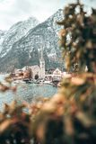 Bell tower of Hallstatt village through leaves royalty free stock photography