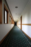 Hallway. Long hallway with white wall Stock Photography