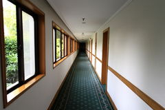 Hallway. Long hallway with white wall Royalty Free Stock Image